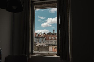 mandatory remote worker looks out of Portugal window