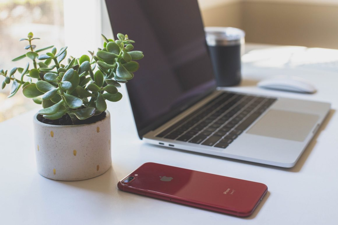 a laptop and phone of a person working remotely