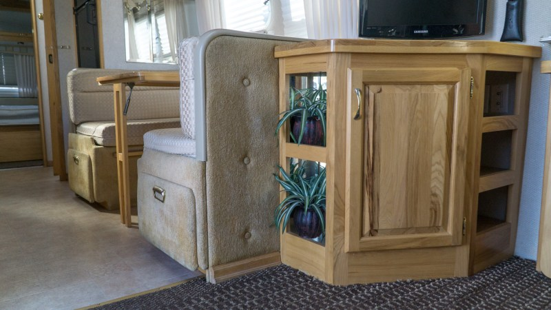 A low shot of the TV entertainment center and nook area