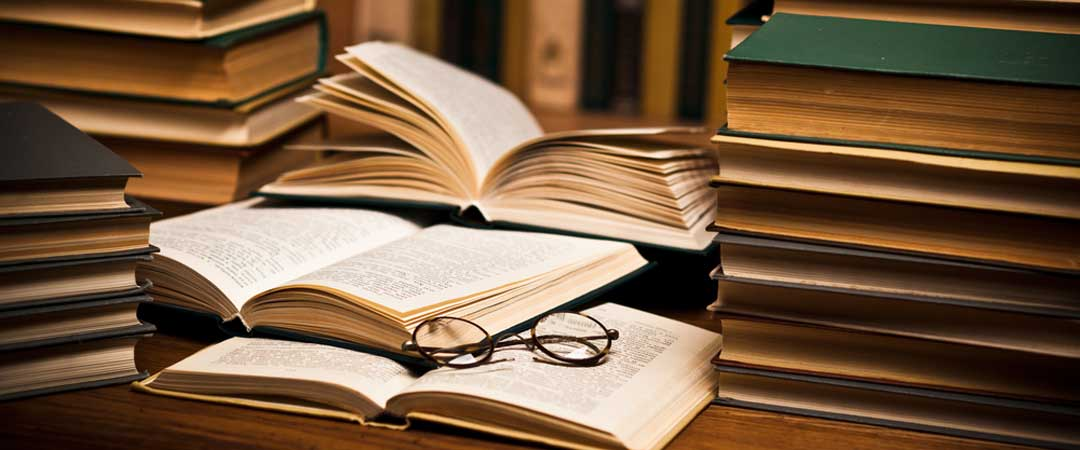Research books with glasses