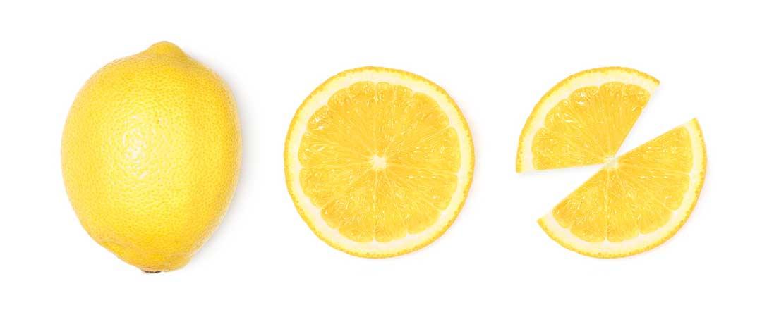 A whole lemon and 2 sliced lemons