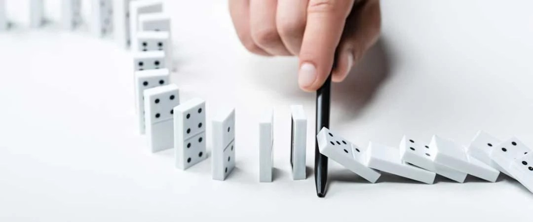 Prevent dominos from falling