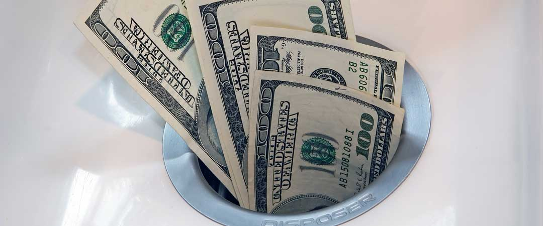 100 dollar bills in a garbage disposal drain