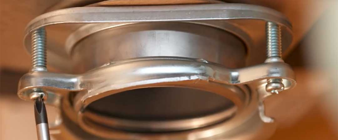 Tighten bolts to secure the mounting ring