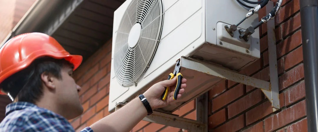 AC professional working on outside unit