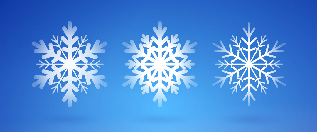 Three snow flakes on a blue background