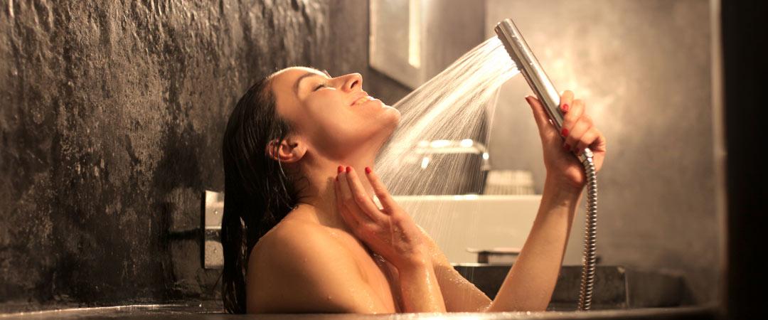 Woman enjoying a hot shower