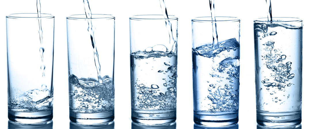 5 Glasses being filled with water