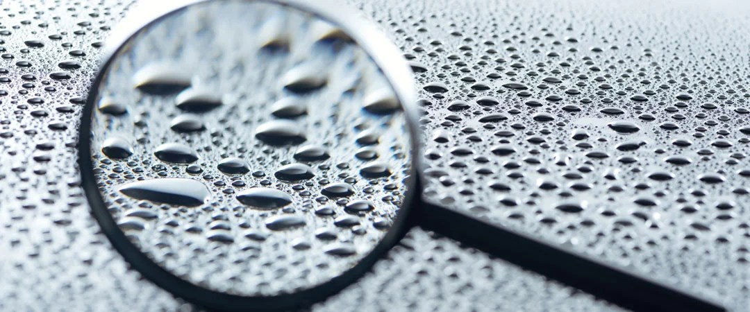 Magnifying glass with beaded water