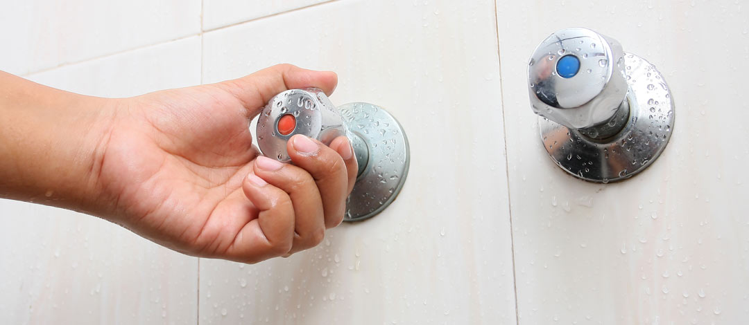 Turning hot water handle in shower