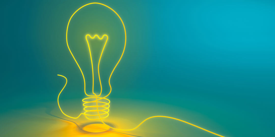 Hand drawn light bulb on a blue background