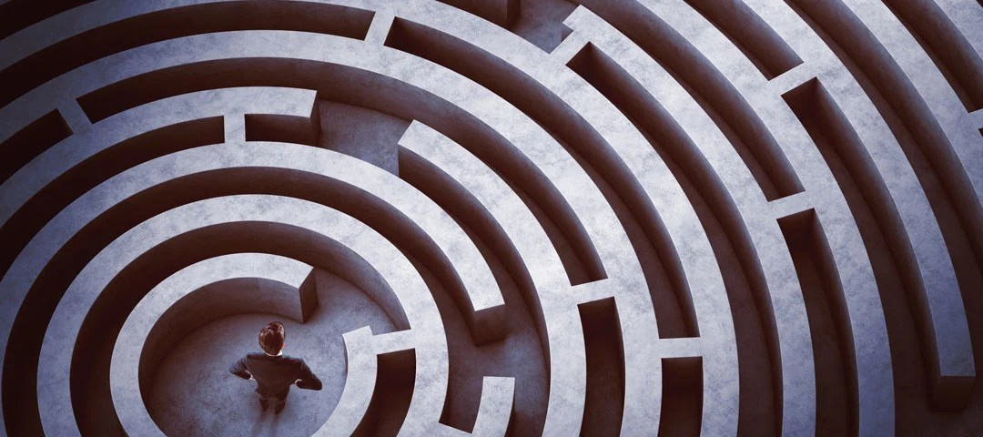 Man standing in the middle of a maze