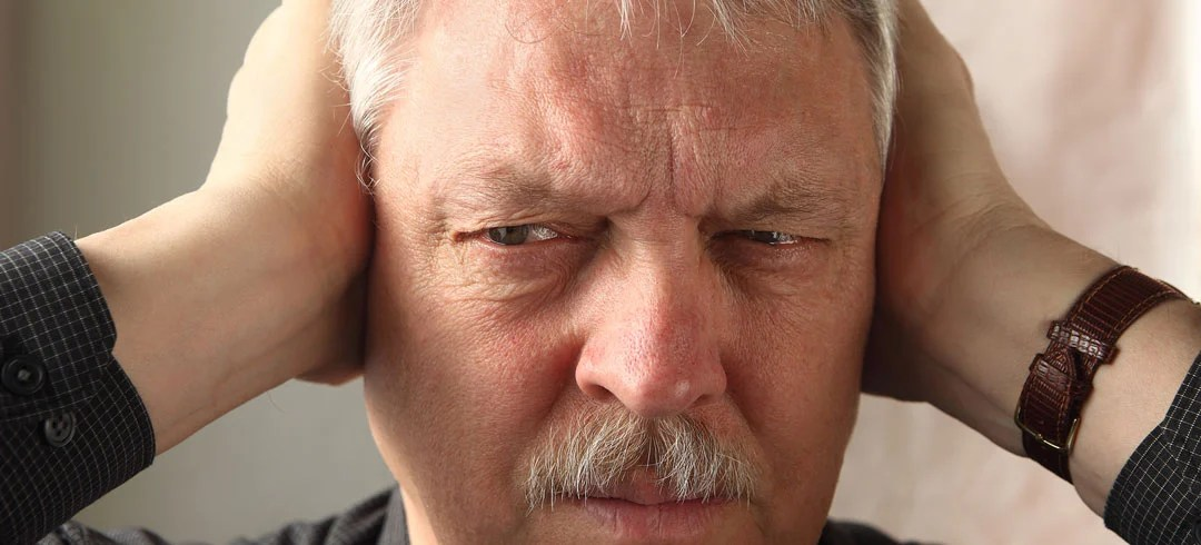 Man holding his ears