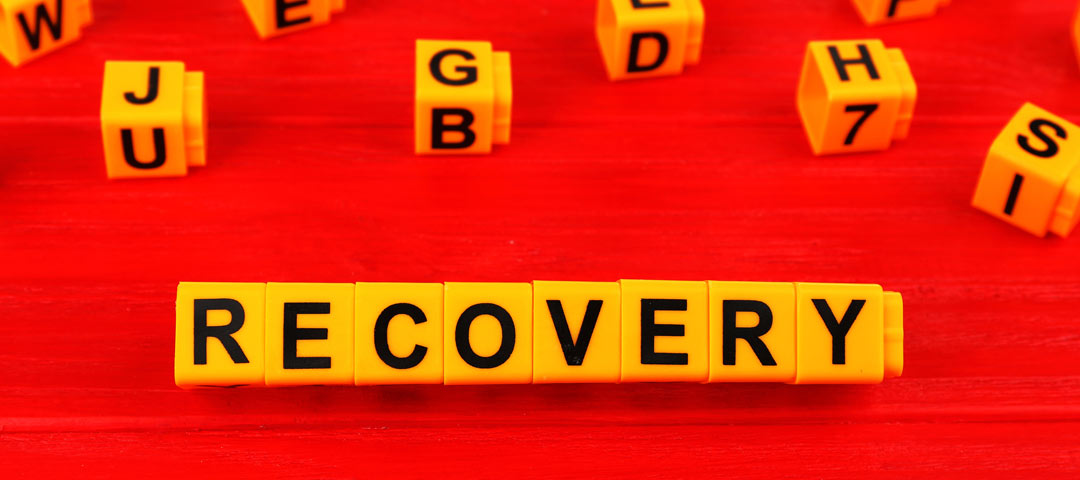 Recovery written in yellow blocks on a red background