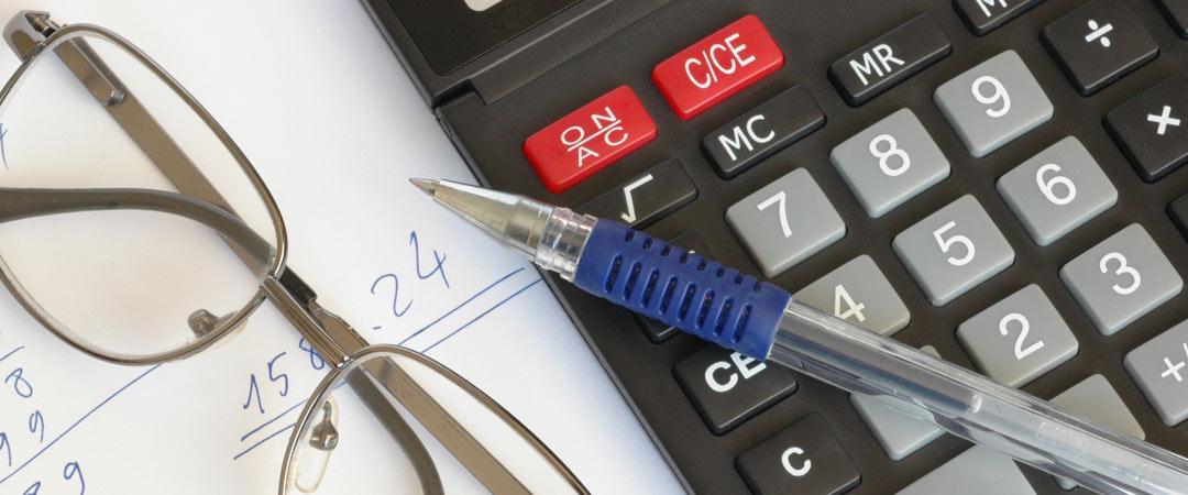 Pen, paper, glasses and calculator
