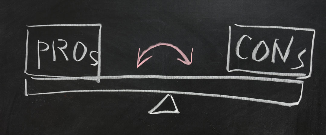 pros and cons on a balance drawn on a chalk board