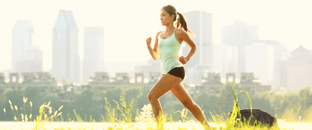 Woman running with city in background