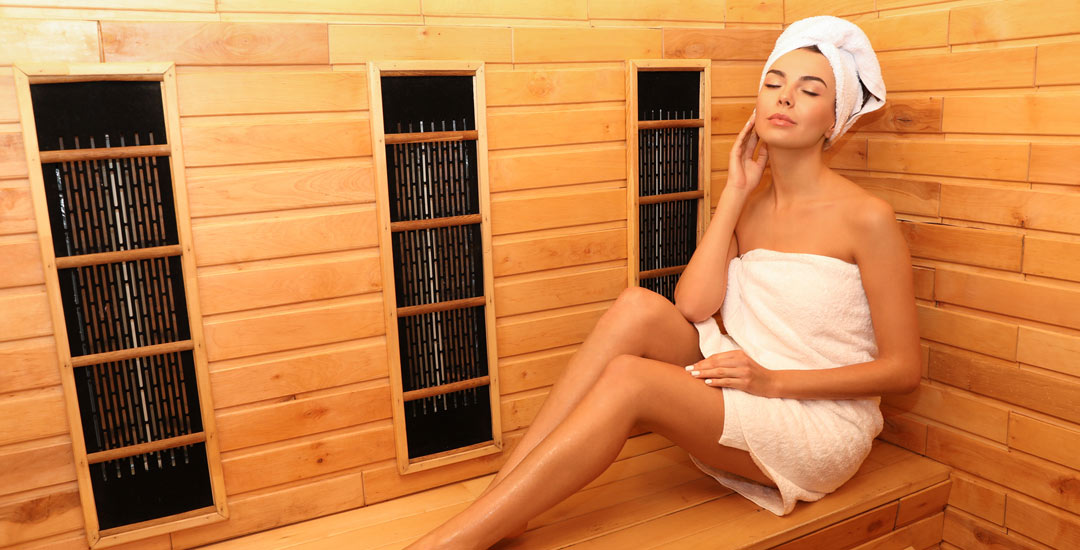 Woman in an infrared sauna