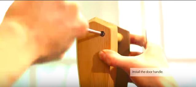 Attaching the handle to the sauna door