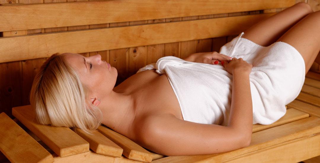 Woman enjoying a sauna