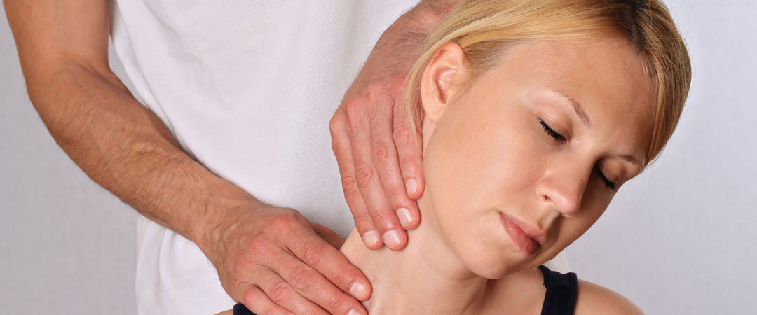 Woman getting her neck worked on by a doctor