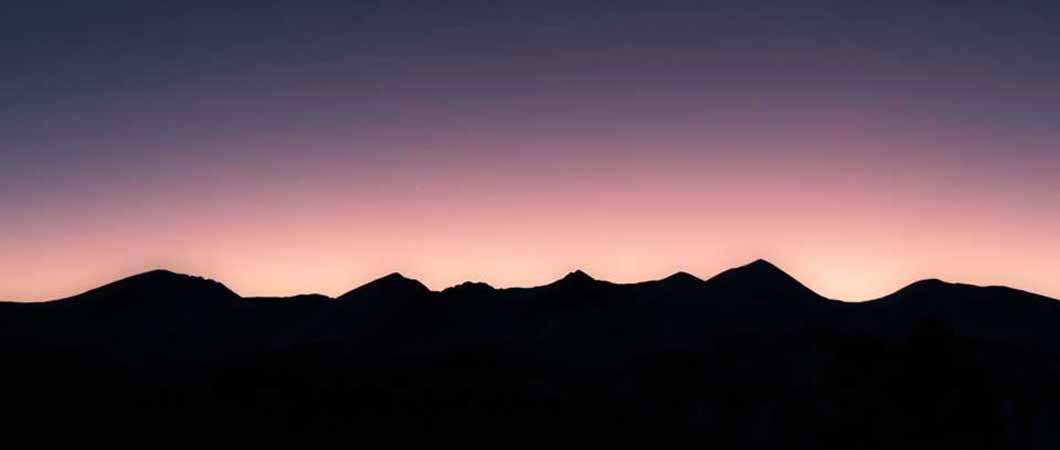 Sunrise behind a mountain range
