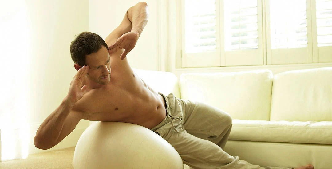 Man doing sit ups on a ball