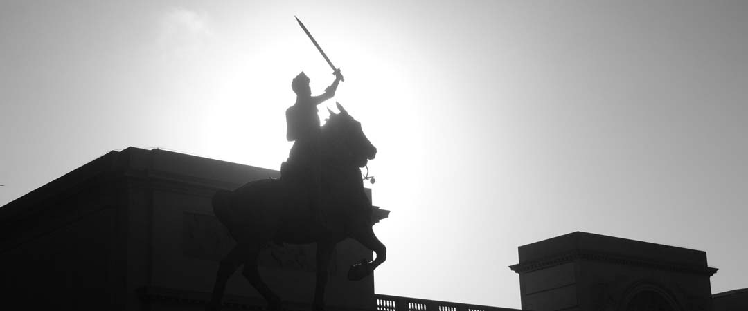 Knight on a horse with a drawn sword