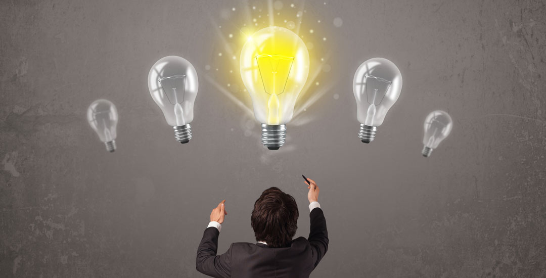 Man standing in front of 5 light bulbs