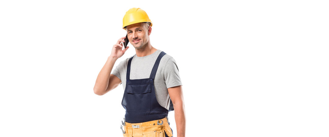 Plumber answering his cell phone