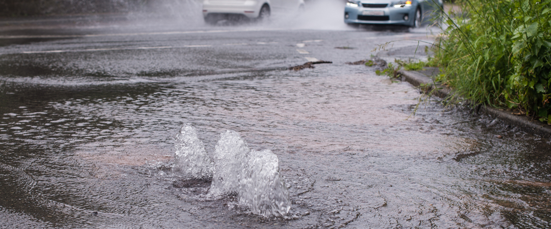 City water main burst and flooding the street