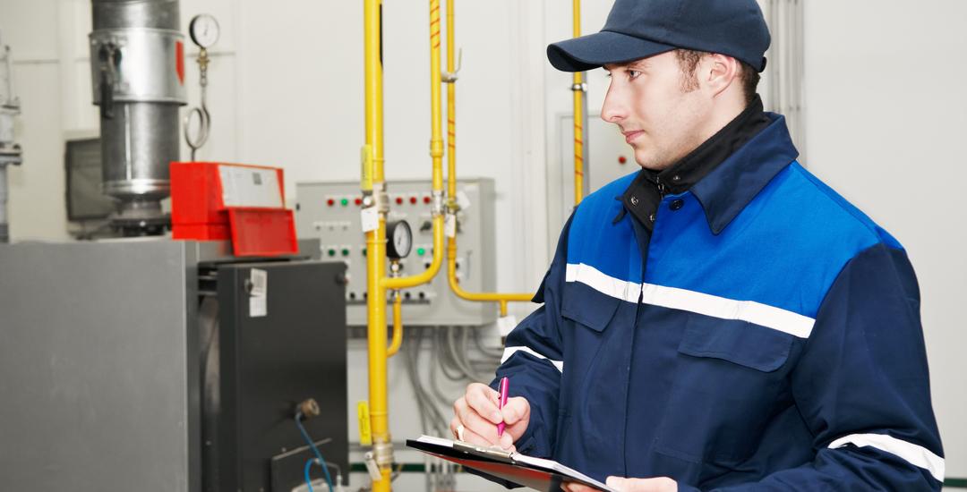 Repairman assessing furnace