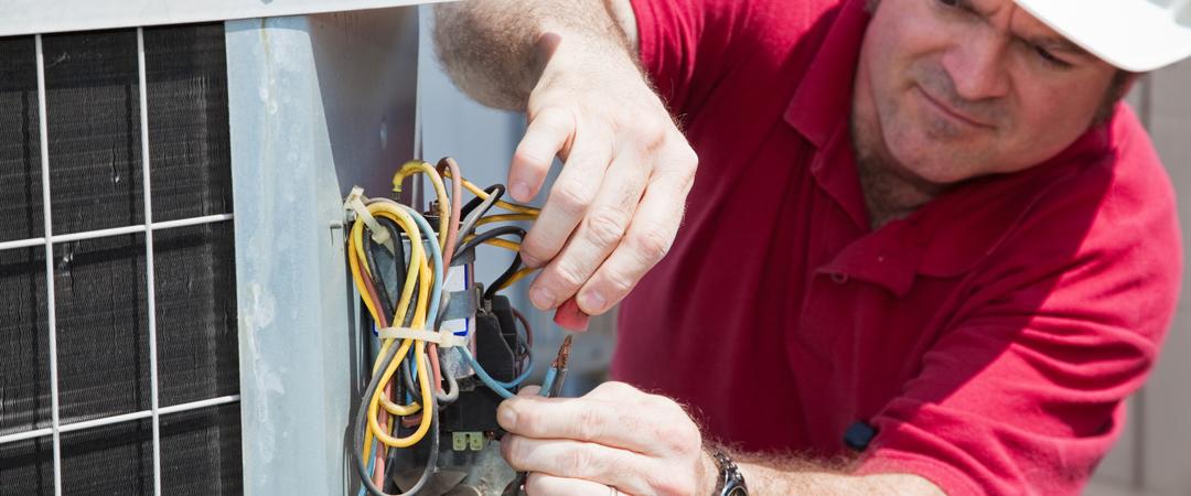 Repairman working on HVAC Electrical