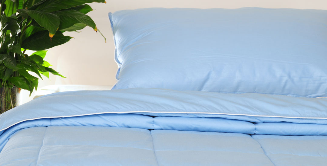 Blue bed with duvet cover