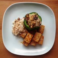 sauteed tofu with rice stuffed green pepper