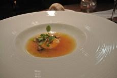 Chicken consomme - poached egg yolk, chive oil, girolles, sorrel