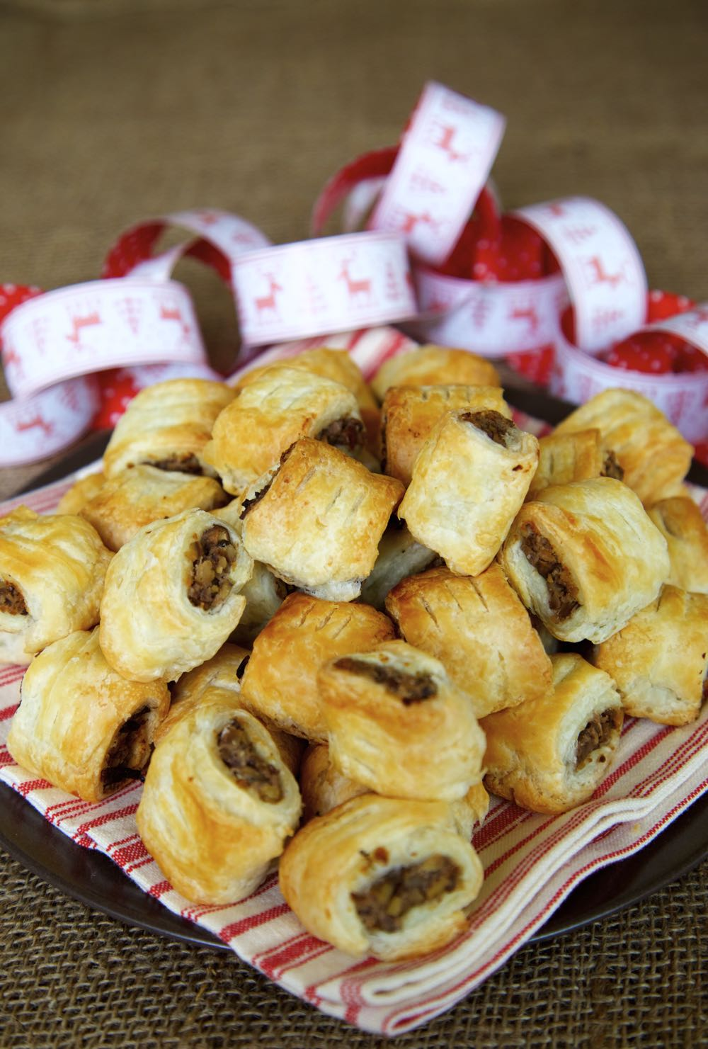 Vegan Christmas Canapés - mini vegan sausage rolls filled with chestnuts, mushrooms, red wine and herbs for a deeply savoury nibble.