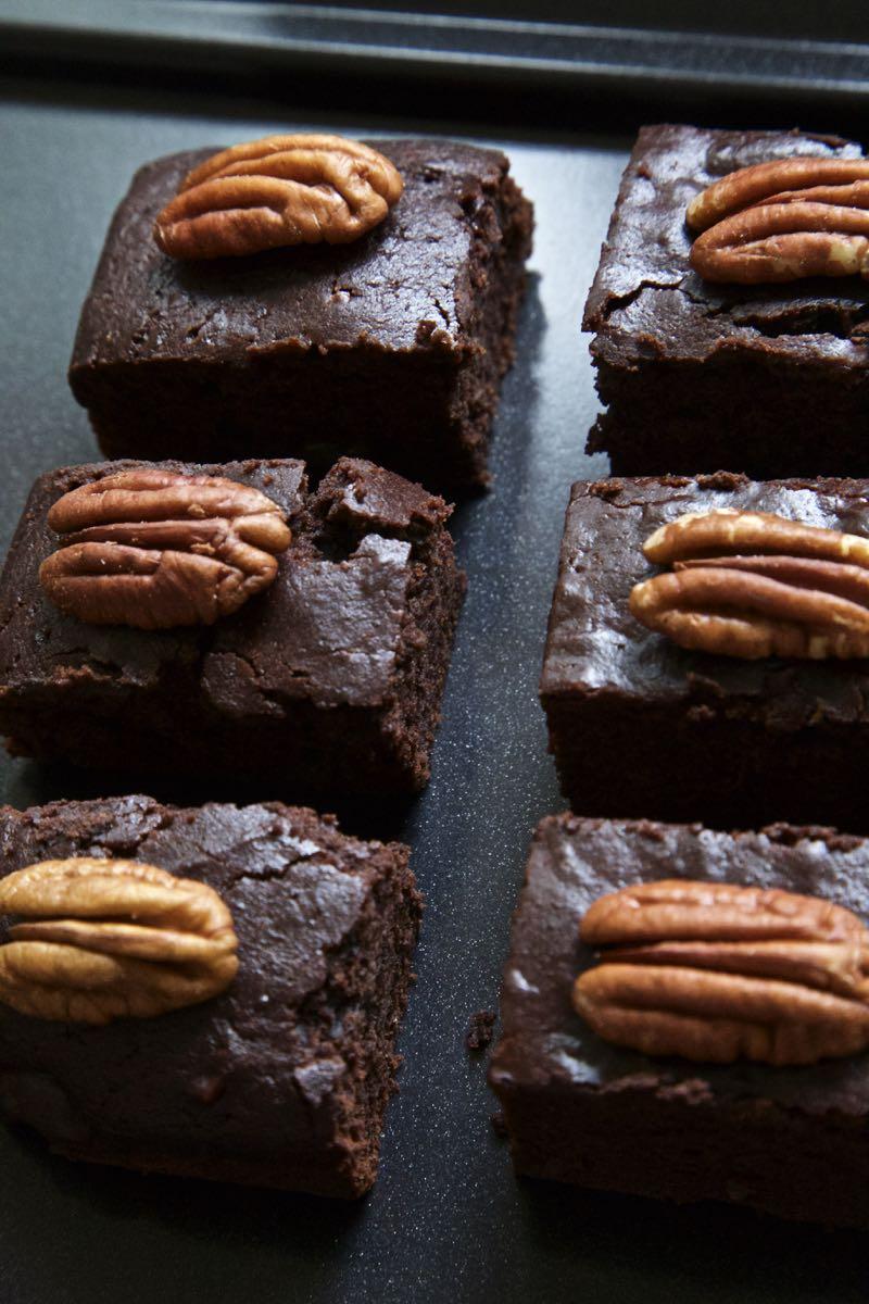 Easy traybake brownies, vegan pumpkin brownies topped with pecan nuts