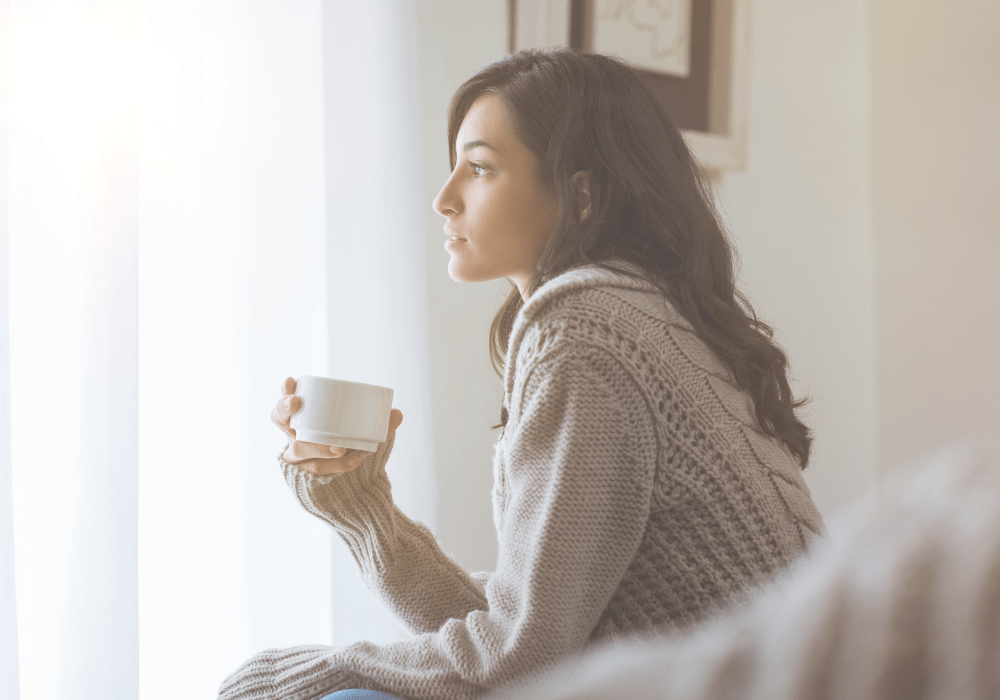 how to unplug - woman thinking with cup in hand