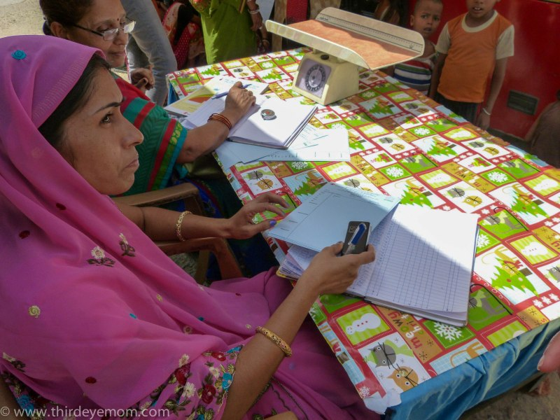 A Healthcare worker registering patients to be seen by the Mobile Health Unit in Delhi