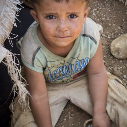 A child plays in the dirt at a tented refugee settlement in Lebanon, near the Syrian border. Jonathan Hyams/Save the Children