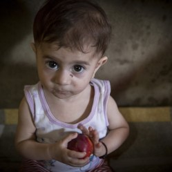 Maya * 11 months, at her home in a disused industrial building in Lebanon near the Syrian border *All names have been changed to protect identities. Photo credit: Jonathan Hyams/Save the Children