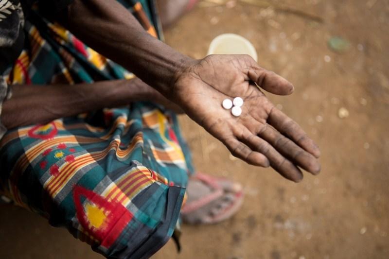 Women holding NTD pills