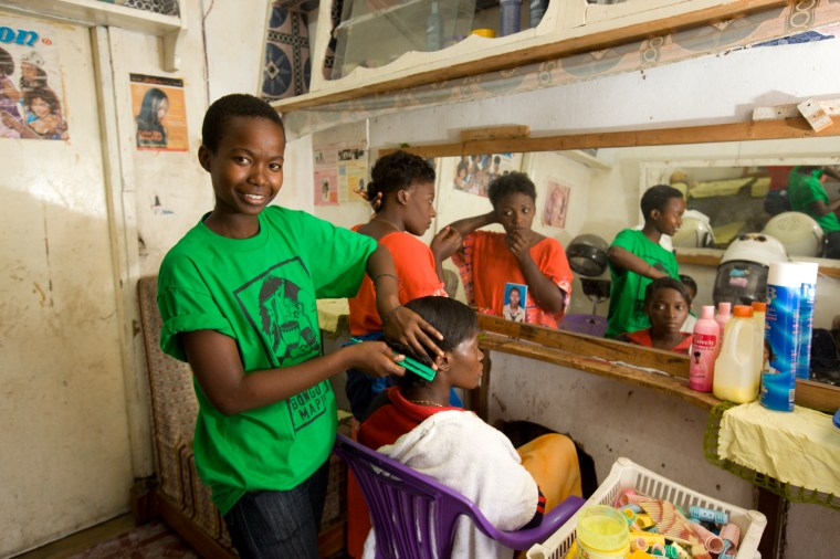 Processed by: Helicon Filter;  BRAC Tanzania 2010 Dodoma Jackline Chikusa (in green), ELA member, received beauty salon training and now works in her own salon.