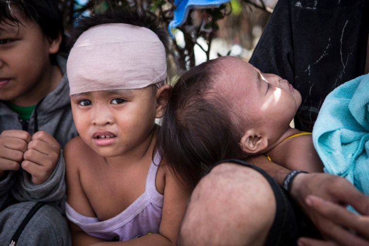 Dada, 3, sits and waits with his family at Tacloban airport along with hundreds of other families who are trying to escape the aftermath of Typhoon Haiyan. Dada sustained a head injury during the deadly storm. Save the Children has launched a US$ 30 million appeal to assist 500,000 beneficiaries. We believe 4.3 million people have been affected (including 2 million seriously affected). Immediate needs are water, hygiene and sanitation (WASH), food, medicines, shelter, psychosocial support, flashlights, debris clearance, logistics and communications. Access is a major challenge due to damage caused by the Haiyan. Photo credit: Save the Children