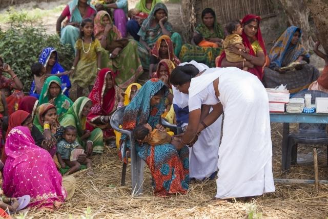 Roti Mushahari, India, 2013 Routine immunization in progress in Roti Mushahari village in Bihar, India. More children than ever before are getting vaccinated, driving child mortality down. Photo credit: Gates Foundation