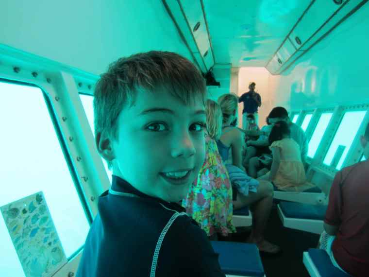 Inside the semi-submerged submarine you could hardly see a thing! Here is my son Max.