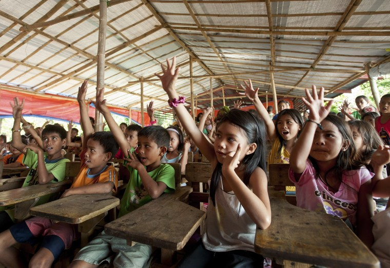 hildren respond to a hygiene promotion class at a mobile Child Friendly Space on one of the islands off the coast of Panay, Philippines. Photo credit: Susan Warner/Save the Children