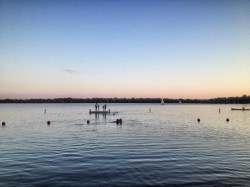 Swimming out to the dock at dusk.