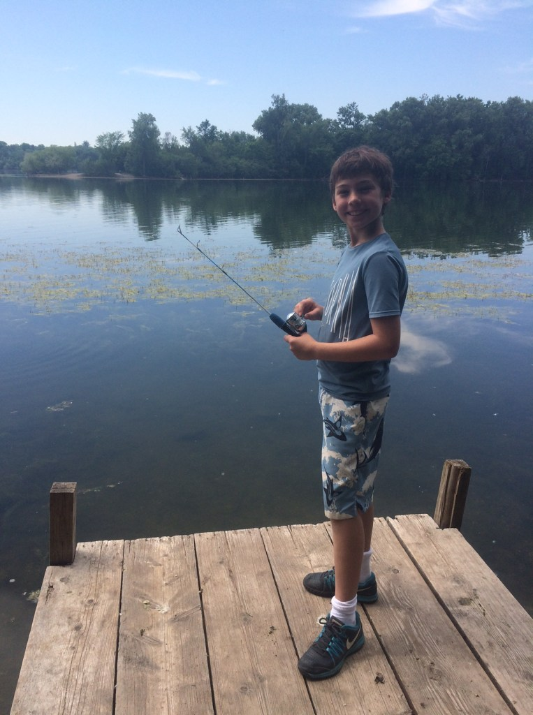 """Meanwhile Max is at a week long """"bike, swim, paddle and fish camp"""". He biked 25 miles yesterday!"""